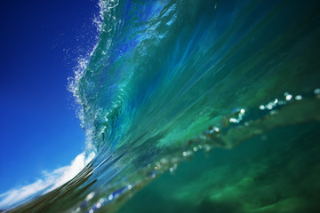 Ocean wave curling in barrel shape. Surfing background for water sport design