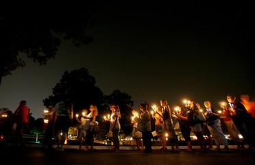 Elvis Presley fans participate in a candlelight vigil inside Graceland in Memphis