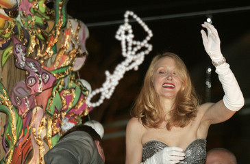 Patricia Clarkson throws beads during Mardi Gras parade in New Orleans