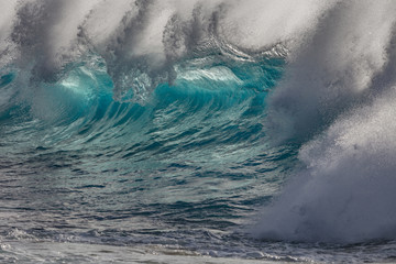 Blue Ocean wave breaking