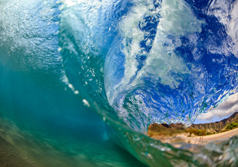 Wall Mural - Sea wave closing against hawaiian beach background. Shot splitted by waterline to underwater part and air with lip