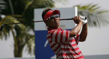 Asia's Thongchai Jaidee of Thailand tees off on the third hole at the Royal Trophy golf tournament in Chonburi province