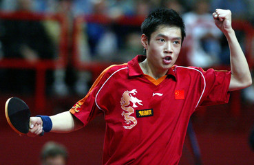 QIU OF CHINA RAISES HIS FIST AS HE WON AGAINST BOLL OF GERMANY DURINGWORLD TABLE TENNIS ...