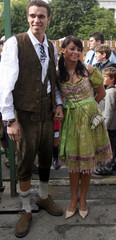 Bayern Munich's Valerien Ismael and his girlfriend Karolina Brylka arrive for a visit at the world biggest beer festival, the Oktoberfest in Munich