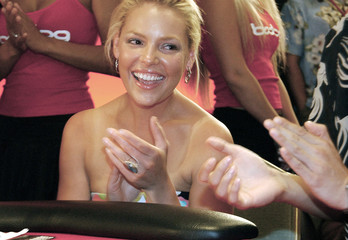 Heigl smiles as she is eliminated in celebrity poker tournament in Honolulu.