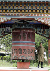 Bhutanese man prays in a monastery in the Bhutanese border town of Phuentsholing