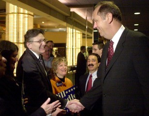 BILL BRADLEY SHAKES HANDS WITH SUPPORTERS.
