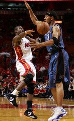 Heats' Dwyane Wade passes around Washington Wizards Jeffries in Florida.