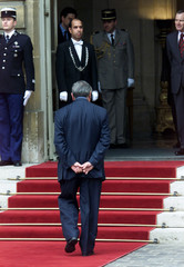 Newly-appointed Prime Minister Jean-Pierre Raffarin enters the Hotel Matigon [after he bid farewell ..