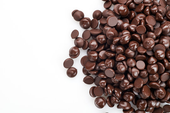 Chocolate drops on white background