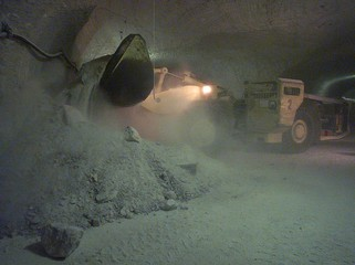 A EXCAVATOR CARRIES SALT CHUNKS IN THE SALT GALLERY OF GORLEBEN.