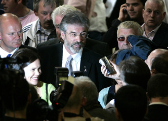 Sinn Fein party leader Gerry Adams arrives to attend a count for the Irish elections in Dublin