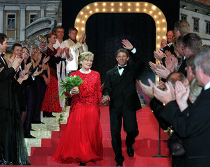 HAIDER WALTZES WITH HIS WIFE CLAUDIA AT A BALL IN KLAGENFURT.