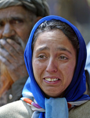 Kashmiri Muslim woman weeps after seeing destruction of residential houses during gun battle in Kangan