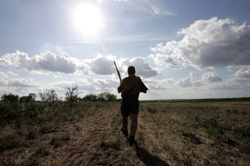 Chumley walks to retrieve a dove during the 36th Annual One Arm Dove Hunt in Olney