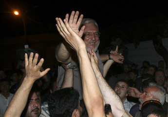 Aziz Dweik is greeted upon arrival to his house in Hebron