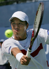 Hyung-Taik Lee hits a return to Alberto Martin during their U.S. Open match.