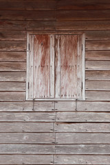 Old wood windows on the wooden wall.