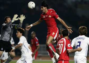 South Korea's goalkeeper Lee Woon-jae blocks the ball from Bahrain's Sayed Adnan Mohamed during their 2007 AFC Asian Cup Group D soccer match in Jakarta