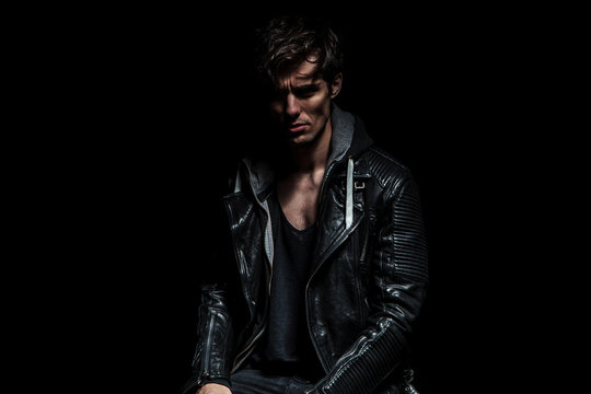 portrait of a serious man in leather jacket
