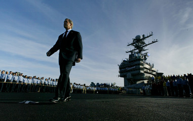 US PRESIDENT BUSH WALKS TO THE STAGE TO DELIVER A SPEECH ABOARD THEAIRCRAFT CARRIER ABRAHAM LINCOLN.