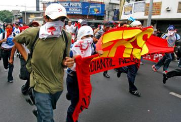 Salvadoran students shout slogans during a demonstration in downtown San Salvador.