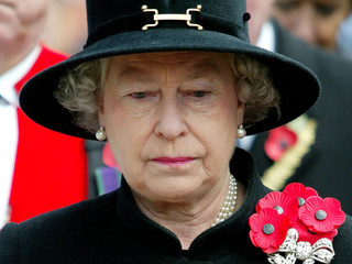 Britain's Queen Elizabeth II looks somber during her visit to the Royal British Legion Field of Reme..