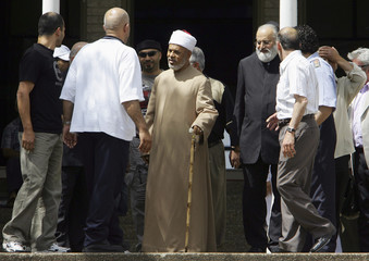 Muslim cleric and the mufti of Australia's biggest mosque Sheikh Taj El-Din Hamid Hilaly, is surrounded by supporters as he leaves midday prayers at Sydney's Lakemba Mosque