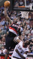 Portland forward Patterson dunks the ball over Philadelphia 76ers center Dalembert.