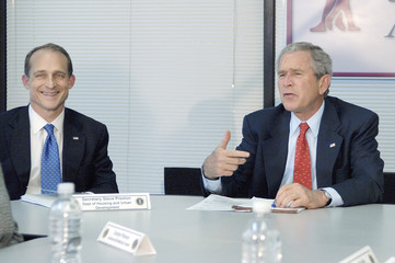 Bush makes a statement with Preston after a round-table discussion about housing counseling in North Little Rock