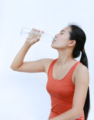 Healthy Woman Drinking Water after Workout, Fitness Girl in Workout Concept on white background.