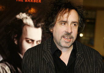 """Tim Burton, director of the DreamWorks Pictures film """"Sweeney Todd: The Demon Barber of Fleet Street"""" poses as he arrives at  a special screening of the film at Paramount Studios in Hollywood"""