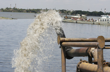 Water is pumped out to the Buriganga river in Mohammadpur