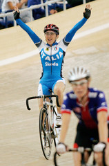 Gold medal winner Giorgia Bronzini of Italy celebrates after winning women's point race final in Carson