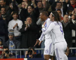 Real Madrid's Baptista celebrates his goal against Lazio with Sergio Ramos during Champions League Group C match in Madrid