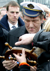 Ukraine's President Viktor Yushchenko receives a sailor's hat and a miniature ship's wheel at a ...