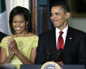 Obama and first lady Michelle Obama smile at the celebration of Cinco de Mayo at the White House in Washington