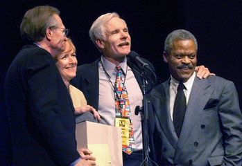 CNN founder Ted Turner (center/right) stands with anchors Larry King (L), Judy Woodruff and Bernard ..