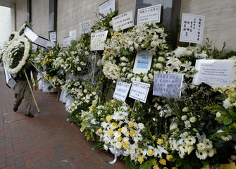FLORAL WREATHS FOR HONG KONG DIVA ANITA MUI OUTSIDE FUNERAL HOME IN HONG KONG.