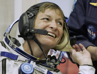 US astronaut Whitson puts on a space suit before boarding a space capsule at the Baikonur cosmodrome in Kazakhstan