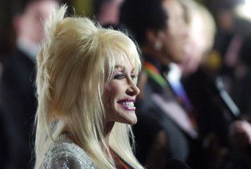 Singer Parton smiles as she arrives for Kennedy Center Honors ceremony in Washington