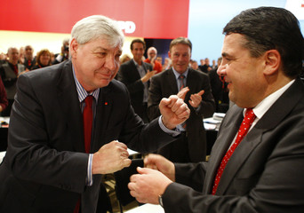 DGB President Sommer congratulates designated SPD leader Gabriel after his speech at party congress in Dresden