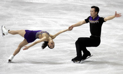 SHEN AND ZHAO FROM CHINA PERFORM DURING THE PAIR'S SHORT PROGRAMME AT THE WORLD FIGURE SKATING ...