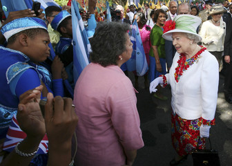 Britain's Queen Elizabeth attends a cultural presentation at the Queen's hall in Port-of-Spain