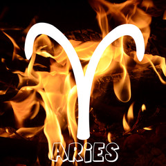 Aries zodiac sign on fire element background
