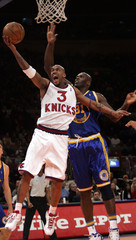 New York Knicks Marbury scores in front of Golden State Warriors Foyle.