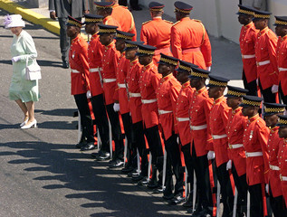 BRITAIN'S QUEEN ELIZABETH II REVIEWS HONOR GUARD AS SHE ARRIVES TOJAMAICA'S PARLIAMENT.