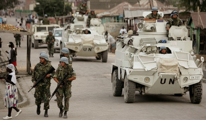 Argentine UN peacekeepers patrol a street in Gonaives