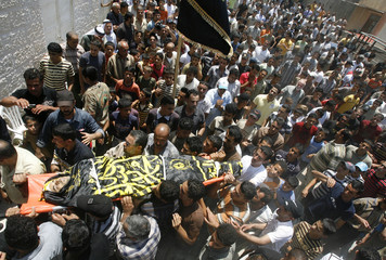 Palestinians carry body of Islamic Jihad commander Abu Ghali during funeral in Jenin