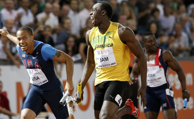 Bolt crosses the finish line ahead of Spearmon in the men's 4 x 100 meters relay race during the IAAF Golden League athletics meeting in Zurich